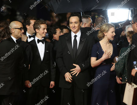From left, Bruce Wagner, Evan Bird, John Cusack and Mia Wasikowska on the red carpet for the screening of Maps to the Stars at the 67th international film festival, Cannes, southern France
