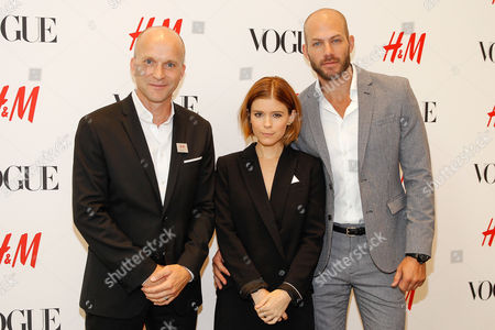 H&M President of North America, Daniel Kulle, from left, actress Kate Mara, and stylist Johnny Wujek pose at the Vogue and H&M fashion week kickoff at H&M on Fifth Avenue, in New York