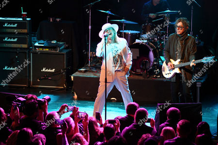 Robin Zander, left, and Tom Petersson, right, of the band Cheap Trick perform at Live Nation's National Concert Day at the Irving Plaza, in New York