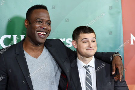 """Kevin Daniels, left, and Kevin Bigley, cast members in the USA series """"Sirens,"""" pose together at the NBCUniversal Cable 2015 Winter TCA Press Tour at The Langham Huntington Hotel, in Pasadena, Calif"""