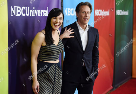 """Kyra Zagorsky, left, and Steven Weber, cast members in the Syfy series """"Helix,"""" share a laugh at the NBCUniversal Cable 2015 Winter TCA Press Tour at The Langham Huntington Hotel, in Pasadena, Calif"""