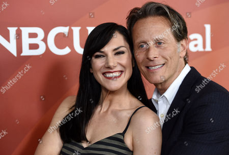 """Kyra Zagorsky, left, and Steven Weber, cast members in the Syfy series """"Helix,"""" pose together at the NBCUniversal Cable 2015 Winter TCA Press Tour at The Langham Huntington Hotel, in Pasadena, Calif"""