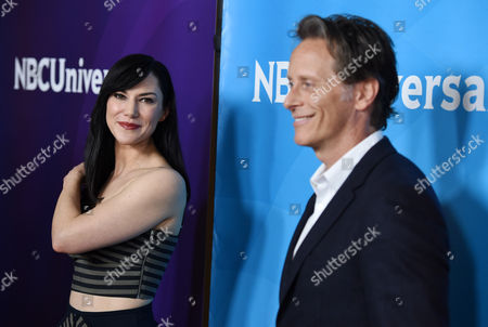 """Kyra Zagorsky, left, a cast member in the Syfy series """"Helix,"""" and fellow cast member Steven Weber pose for photographers at the NBCUniversal Cable 2015 Winter TCA Press Tour at The Langham Huntington Hotel, in Pasadena, Calif"""