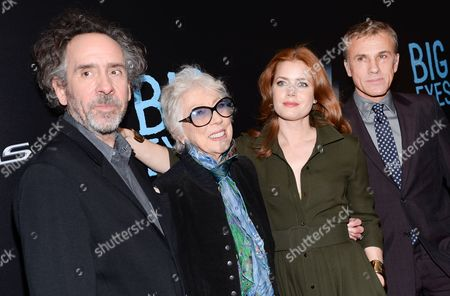 """Directror Tim Burton, left, artist Margaret Keane, actress Amy Adams and actor Christoph Waltz attend the """"Big Eyes"""" premiere at the Museum of Modern Art, in New York"""