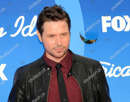 """Michael Johns arrives at the """"American Idol"""" finale at the Nokia Theatre at L.A. Live in Los Angeles. Johns, who appeared in season 7 of the hit Fox singing competition and was voted off in an eighth-round stunner, has died. He was 35. The network and his family released statements, confirming the Australian-born singer's death. The Hollywood Reporter says Johns died Friday. A cause of death wasn't immediately available"""