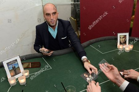 Magician Drummond Money-Coutts is seen performing at the Quintessentially Foundation's annual poker evening in association with Betfair at the Savoy Hotel on in London. The Quintessentially Foundation is the charitable arm of Quintessentially Lifestyle