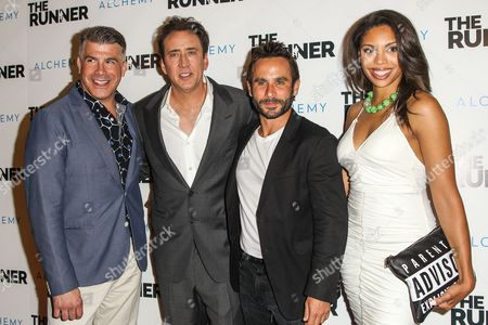 """From left, Bryan Batt, Nicolas Cage, Austin Stark and Ciera Payton attend a special screening of """"The Runner"""" at the TCL Chinese 6 Theatre on in Los Angeles"""