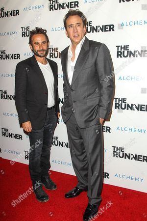 """Austin Stark, left, and Nicolas Cage attend a special screening of """"The Runner"""" at the TCL Chinese 6 Theatre on in Los Angeles"""