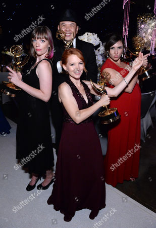 Alexandra Edwards, clockwise, Bernie Su, Tracey Bitterolf, and Tamara Krinsky attend the Governors Ball for the Television Academy's Creative Arts Emmy Awards at LA Convention Center, in Los Angeles