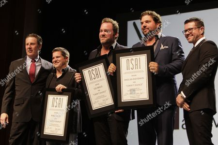 Bart Herbison, left, stands with Bob Hatch, Lee Brice, Dallas Davidson and Lee Thomas Miller at The Nashville Songwriters Hall of Fame Dinner and Induction Ceremony at the Music City Center, in Nashville, Tenn