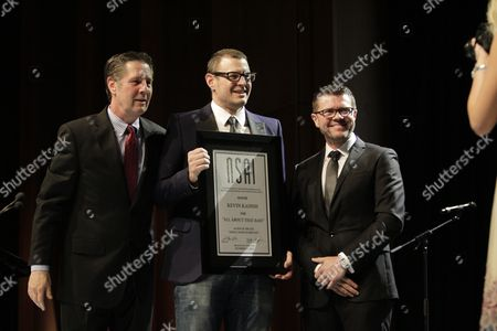 Stock Picture of Bart Herbison, left, stands with Kevin Kadish and Lee Thomas Miller at The Nashville Songwriters Hall of Fame Dinner and Induction Ceremony at the Music City Center, in Nashville, Tenn