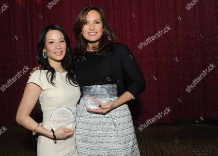 Lucy Liu, left, and Mariska Hargitay pose together after being honored at the 32nd annual Muse Awards presented by New York Women in Film & Television (NYWIFT), in New York. The event also honored Kim Martin, President & General Manager WE tv, Lisa F. Jackson, documentary filmmaker, and Debra Zimmerman, of Women Make Movies