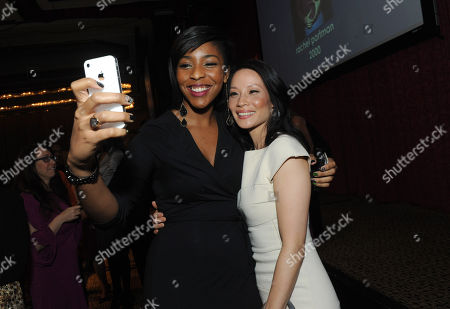 Event emcee Jessica Williams, left, of The Daily Show, takes a picture with honoree Lucy Liu at the 32nd annual Muse Awards presented by New York Women in Film & Television (NYWIFT), in New York. The event honored Lucy Liu, Mariska Hargitay, Kim Martin, President & General Manager WE tv, Lisa F. Jackson, documentary filmmaker, and Debra Zimmerman, of Women Make Movies