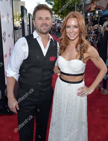 "Aaron MacPherson, left, and Challen Cates arrive at the world premiere of ""A Million Ways To Die In The West"" at the Regency Village Theatre, in Los Angeles"