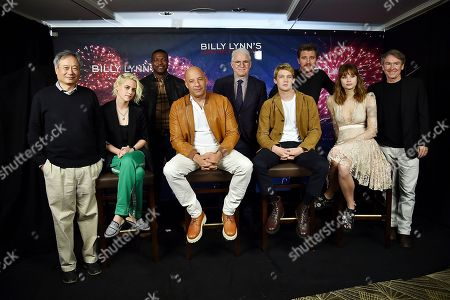"""Director Ang Lee, left, actors Kristen Stewart, Chris Tucker, Vin Diesel, Steve Martin, Joe Alwyn, Garrett Hedlund, Makenzie Leigh and author Ben Fountain participate in a photo call for the Tristar Pictures film, """"Billy Lynn's Long Halftime Walk"""", at the JW Marriott Essex House, in New York"""