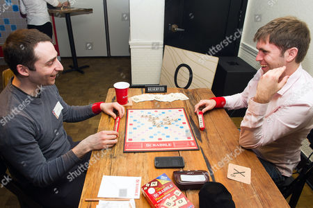 National SCRABBLE Champion Conrad Bassett-Bouchard, right, and competitive SCRABBLE player Will Anderson play the SCRABBLE game during the National SCRABBLE Day event hosted by Hasbro at the Ace Hotel, on in New York