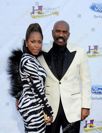 TV personality Steve Harvey, right, and wife Marjorie Bridges arrive at the 11th Annual Ford Neighborhood Awards, on at the MGM Grand Garden Arena in Las Vegas, Nevada