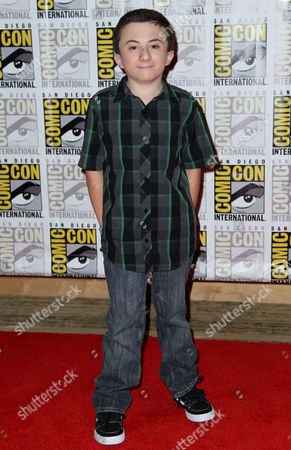 """Actor Atticus Shaffer, from the film """"Frankenweenie"""", arrives at the Disney press line during Comic-Con, in San Diego"""