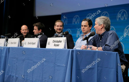Stock Photo of Scott Stephens, and from left, Alex Cary, Bryan Fuller, David Alpert and Christopher Keyser, president of the Writers Guild of America, speak on stage at the Produced By Conference - Day 2 at Warner Bros. Studios, in Burbank, Calif