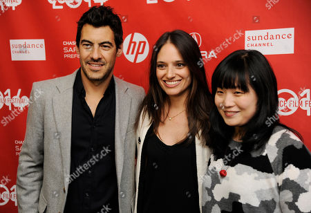 """Jacob Pechenik, left, Stephanie Langhoff, center, and Jennifer Lee, producers of """"The Skeleton Twins,"""" pose together at the premiere of the film at the 2014 Sundance Film Festival, in Park City, Utah"""