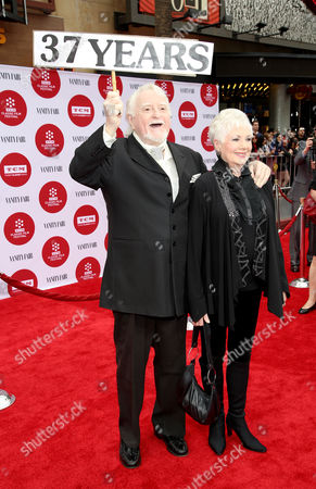 Marty Ingels, left, and Shirley Jones arrive at 2014 TCM Classic Film Festival's Opening Night Gala at the TCL Chinese Theatre on in Los Angeles