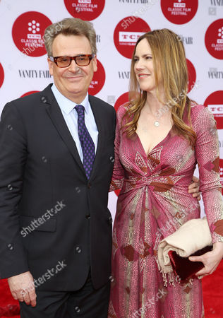 Stock Photo of Greg Proops, left, and Jennifer Canaga arrive at 2014 TCM Classic Film Festival's Opening Night Gala at the TCL Chinese Theatre on in Los Angeles