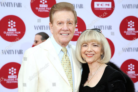 Wink Martindale, left, and Sandy Ferra arrive at 2014 TCM Classic Film Festival's Opening Night Gala at the TCL Chinese Theatre on in Los Angeles