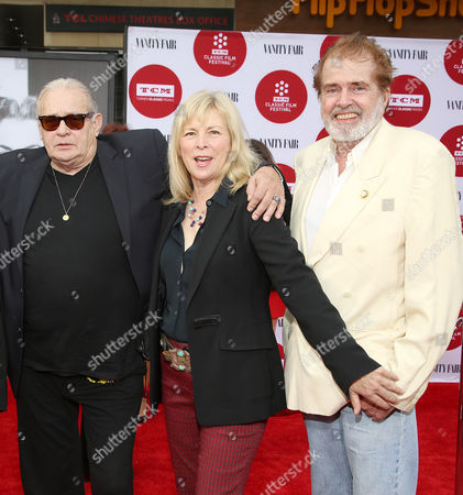 From left, Bo Hopkins, Candy Clark, and Paul Le Mat arrive at 2014 TCM Classic Film Festival's Opening Night Gala at the TCL Chinese Theatre on in Los Angeles