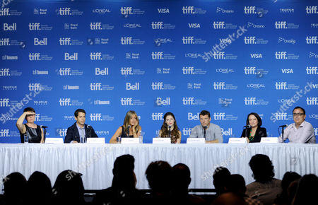 """Moderator Johanna Schneller, and from left, Daniel Barnz, Jennifer Aniston, Anna Kendrick, Sam Worthington, Adriana Barraza and Patrick Tobin attend the press conference for """"Cake"""" on day 6 of the Toronto International Film Festival at the TIFF Bell Lightbox, in Toronto"""