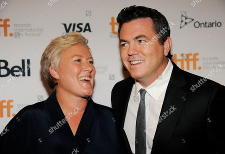 "Stock Picture of Relativity Media president Tucker Tooley, right, poses with Christine Haebler, producer of ""Hector and the Search for Happiness,"" at the premiere of the film at the Winter Garden Theatre during the 2014 Toronto International Film Festival, in Toronto"
