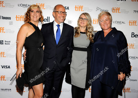 "Stock Photo of Peter Chelsom, second from left, director of ""Hector and the Search for Happiness,"" poses with producers, from left, Trish Dolman, Judy Tossell and Christine Haebler at the premiere of the film at the Winter Garden Theatre during the 2014 Toronto International Film Festival, in Toronto"
