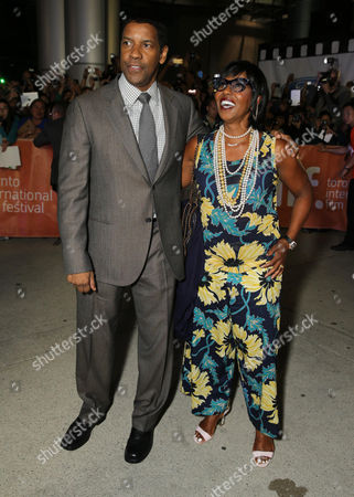 "Stock Picture of Denzel Washington and Pauletta Pearson Washington seen at Columbia Pictures Premiere of ""The Equalizer"" at 2014 TIFF, in Toronto"