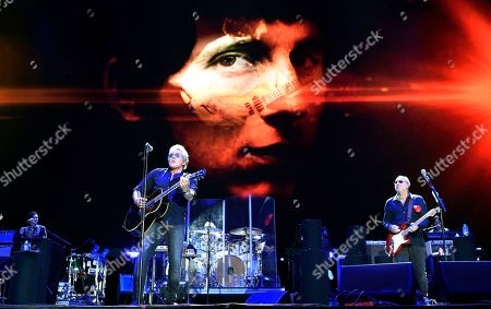 Stock Picture of Roger Daltrey, left, and Pete Townshend of The Who perform in front of an image of their late bandmate John Entwistle on day 3 of the 2016 Desert Trip music festival at Empire Polo Field, in Indio, Calif. Entwistle would have celebrated his 72nd birthday on Sunday