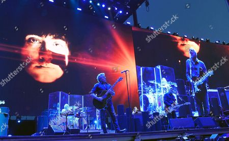 Roger Daltrey, left, and Pete Townshend of The Who perform in front of an image of their late drummer Keith Moon, seen at top left, on day 3 of the 2016 Desert Trip music festival at Empire Polo Field, in Indio, Calif