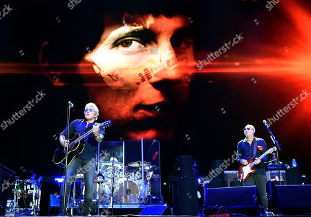 Roger Daltrey, left, and Pete Townshend of The Who perform in front of an image of their late bass player John Entwistle on day 3 of the 2016 Desert Trip music festival at Empire Polo Field, in Indio, Calif. Entwistle would have celebrated his 72nd birthday on Sunday