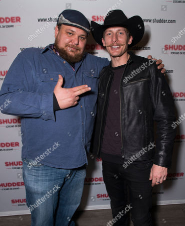Michael Villar, left, and James Landry Hebert pose at the Shudder/Midnight party during the 2016 Sundance Film Festival, in Park City, Utah