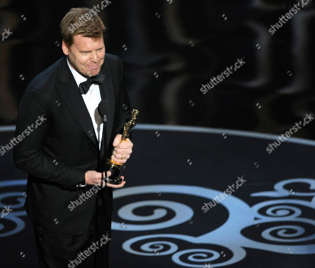 """John Kahrs accepts the award for best animated short film for """"Paperman"""" during the Oscars at the Dolby Theatre, in Los Angeles"""