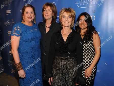 """MAY 2: (L-R) Executive producers Abigail Disney, Pamela Hogan, Gini Reticker, and senior producer Nina Chaudry arrive at the Academy of Television Arts & Sciences Presents """"The 5th Annual Television Academy Honors"""" at the Beverly Hills Hotel on in Beverly Hills, California"""