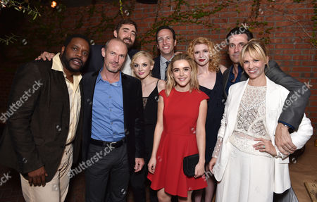 Chad L. Coleman, and from left, Toby Huss, Lee Pace, Emily Kinney, Charlie Collier, president and general manager of AMC, Kiernan Shipka, Kasha Kropinski, Jon Hamm and January Jones attend the AMC Holiday Party at Dominick's, in West Hollywood, Calif