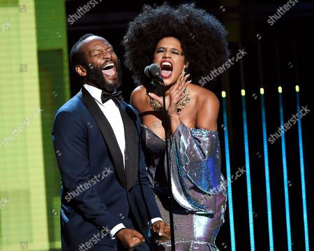 Modesto Lacen, left, and Jeimy Osorio introduce a tribute to Celia Cruz at the Latin American Music Awards at the Dolby Theatre, in Los Angeles