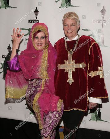 Recording artist Kate Pierson, left, and Monica Coleman, right, attend New York Restoration Project's 18th Annual Hulaween gala on in New York