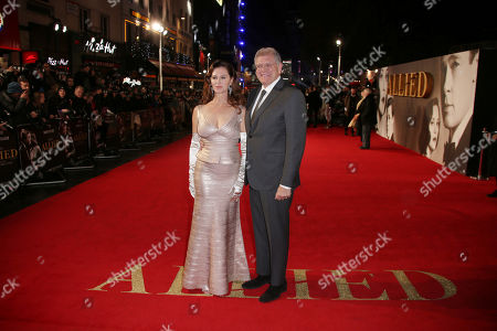 Stock Photo of Director Robert Zemeckis, right, and his wife Leslie Harter Zemeckis pose for photographers upon arrival at the premiere of the film 'Allied' in London