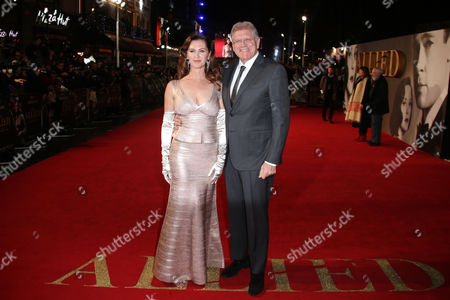Robert Zemeckis and wife Leslie Zemeckis pose for photographers upon arrival at the premiere of the film 'Allied' in London