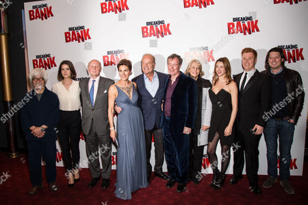 From left, Togo Igawa, Sonya Cassidy, Tamsin Greig, Kelsey Grammer, director Vadim Jean, guest, Julie Dray, Daniel Morgan and guest pose for photographers upon arrival at the premiere of the film 'Breaking the Bank' in London
