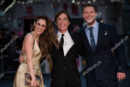 Stock Photo of From left, actors Madeline Mulqueen, Cillian Murphy and Jack Reynor pose for photographers upon arrival at the premiere of the film 'Free Fire', in London