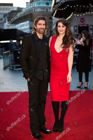 Actor Sharlto Copley and model Tanit Phoenix pose for photographers upon arrival at the premiere of the film 'Free Fire', which is the London Film Festival closing gala screening in London