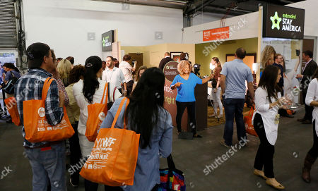 Festival attendees line up to visit the Extended Stay America traveling hotel room, to take selfies with Food Network host Sunny Anderson and to donate to No Kid Hungry, at the New York City Wine & Food Festival