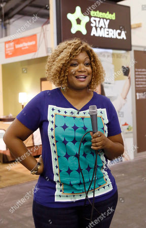 Stock Photo of Food Network host Sunny Anderson is pictured outside the Extended Stay America traveling hotel room, seen at the New York City Wine & Food Festival