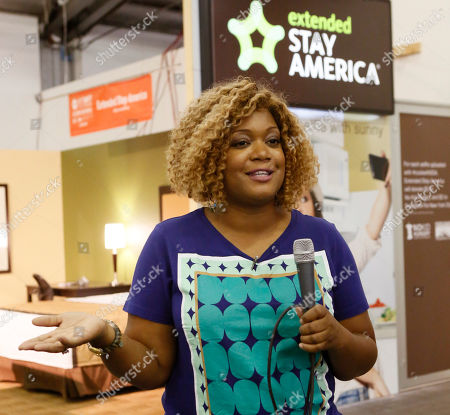 Stock Image of Food Network host Sunny Anderson is pictured outside the Extended Stay America traveling hotel room, seen at the New York City Wine & Food Festival