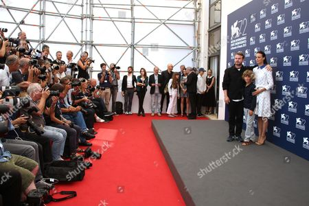 From right, Berenice Bejo, Tom Sweet and Brady Corbet pose for photographers at the photo call for the film The Childhood of a Leader at the 72nd edition of the Venice Film Festival in Venice, Italy, . The 72nd edition of the festival runs until Sept. 12